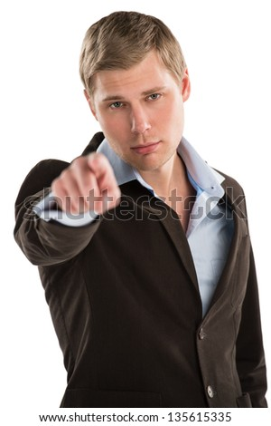Portrait of an young male business executive pointing at you against white background
