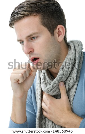 portrait of an young man coughing with fist - stock photo