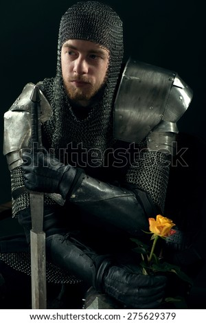 portrait of ancient knight with yellow rose - stock photo