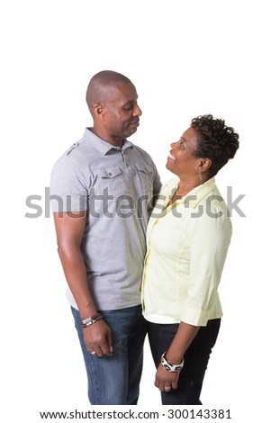 Portrait of and older couple standing close looking at each other, isolated - stock photo