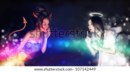 Portrait of angel and devil girls and copyspace between them. - stock photo