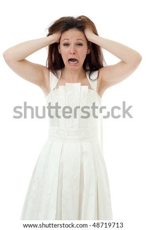 Portrait of angry bride pulling her hair - stock photo