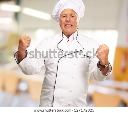 Portrait Of Angry Chef, Indoor - stock photo