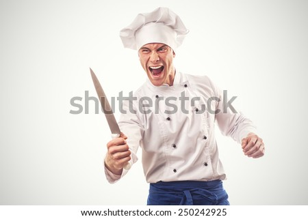 Portrait of angry chief cook with a knife