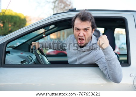 Portrait of angry driver at the wheel. Negative human emotions face expression