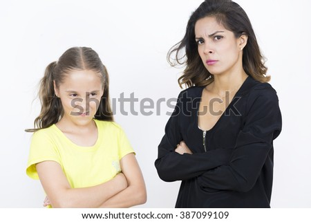 Portrait of Angry Girl and Mother Over White Background