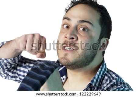 Portrait of angry man about to punch - stock photo
