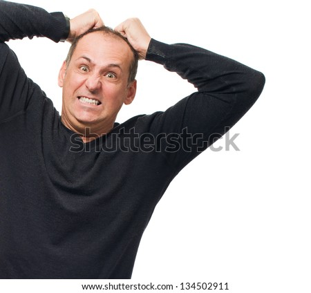 Portrait Of Angry Man Pulling His Hair On White Background - stock photo