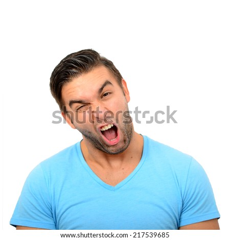 Portrait of angry man screaming against white background - stock photo