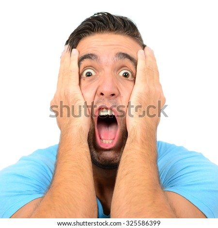 Portrait of angry man screaming and pulling hair against white background