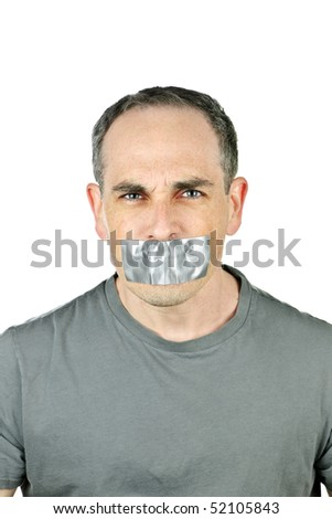 Portrait of angry man with duct tape over his mouth - stock photo
