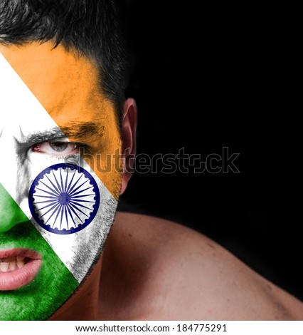Portrait of angry man with painted flag of India - stock photo
