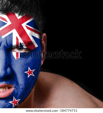 Portrait of angry man with painted flag of New Zealand
