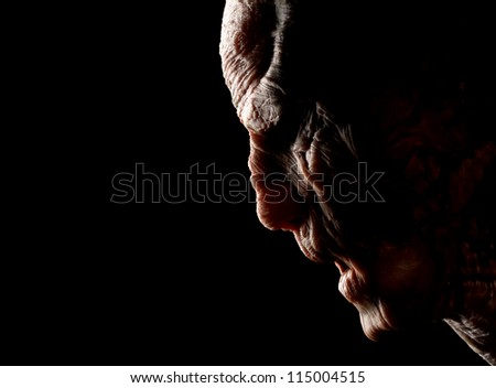 Portrait of angry monster. Isolated on black - stock photo