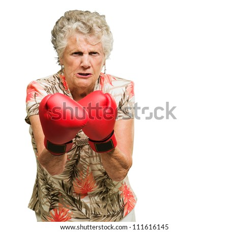 Portrait Of Angry Senior Woman Boxer Isolated Over White Background