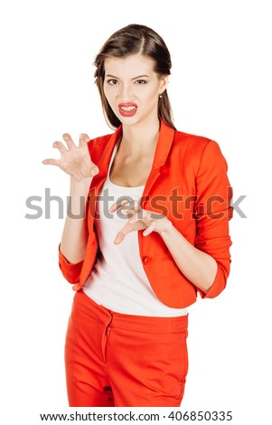 Portrait of angry, serious young business woman in red suit gesturing Like Cat Claw. human emotion expression and lifestyle concept. image on a white studio background. - stock photo