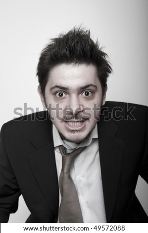 Portrait of angry stressed businessman - stock photo