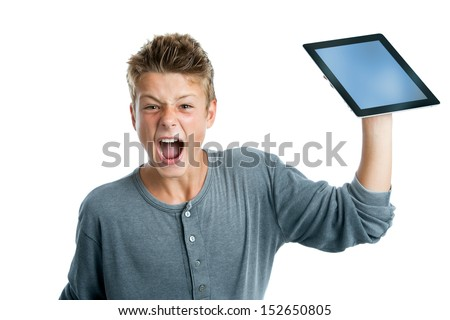Portrait of  angry teen boy about to smash digital tablet. Isolated on white. - stock photo