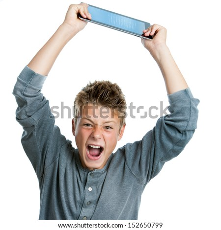 Portrait of angry teen raising digital tablet.Isolated on white background.