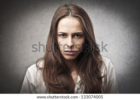portrait of angry woman - stock photo