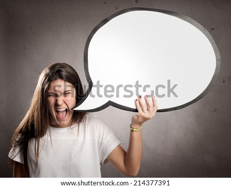 portrait of angry young girl holding a speech bubble - stock photo
