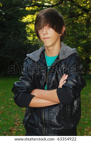 Portrait of annoyed young man in the park