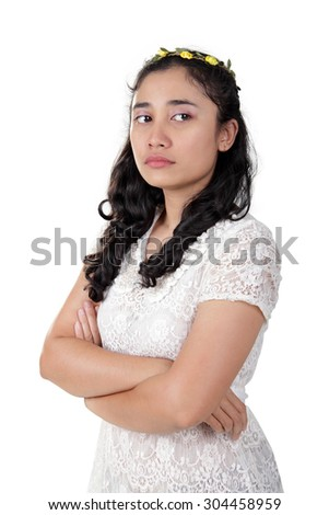 http://thumb7.shutterstock.com/display_pic_with_logo/3092237/304458959/stock-photo-portrait-of-antagonist-asian-lady-with-arrogant-face-standing-with-her-arms-crossed-isolated-on-304458959.jpg