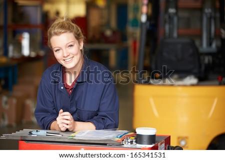 Portrait Of Apprentice Engineer In Factory - stock photo