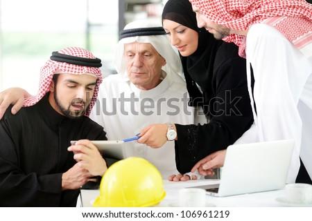 Portrait of araabic architect explaining his project - stock photo