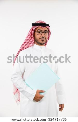 Portrait of Arab businessman holding folder - stock photo