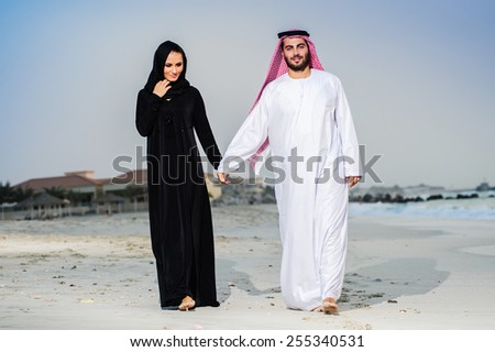 Portrait of Arabic dressed yang couple - stock photo