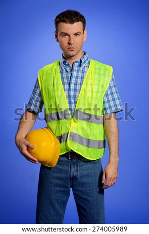 Portrait of architect in coveralls holding hardhat - stock photo