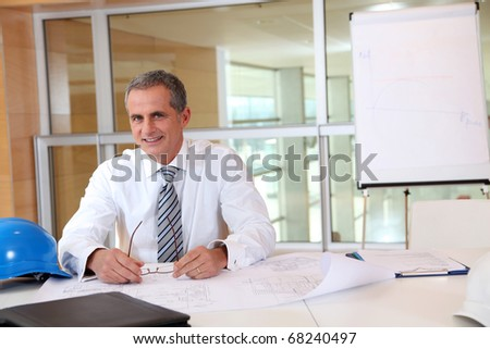 Portrait of architect in the office - stock photo