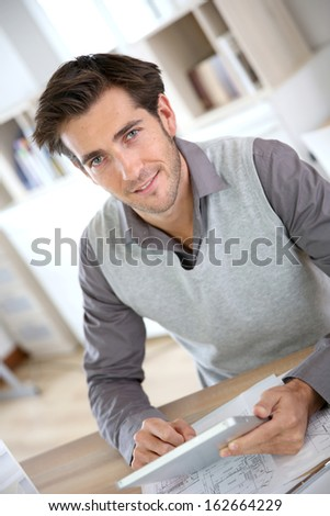 Portrait of architect using tablet in office