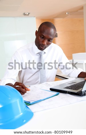 Portrait of architect working in office - stock photo