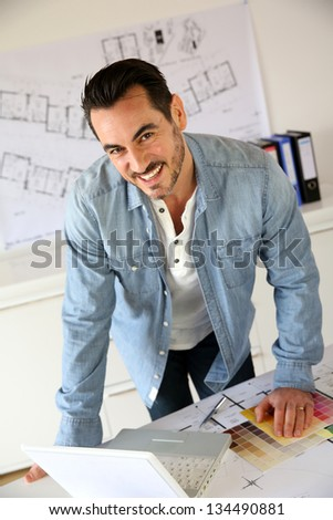 Portrait of architect working on project - stock photo