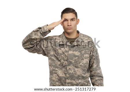 Portrait of army soldier saluting against white background - stock photo
