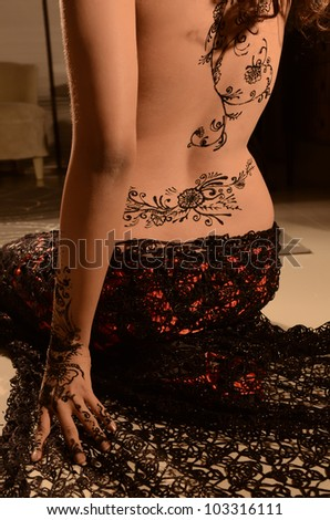 Portrait of artistic beautiful woman painted with black - stock photo