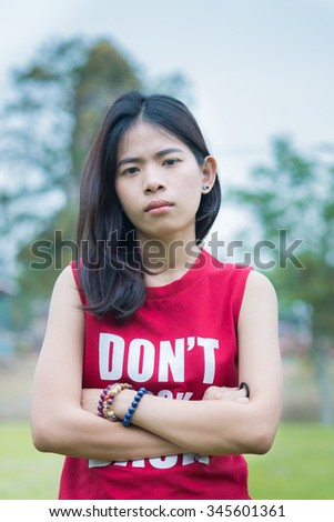 Portrait of asia beautiful lady feeling serious angry with nature background