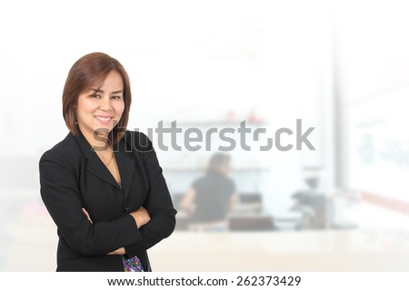 Portrait of asia business woman 30 - 40 year old in her office background .Mixed Asian / Caucasian businesswoman.Positive emotion - stock photo
