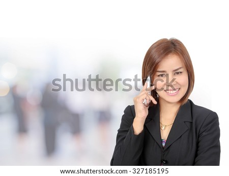 Portrait of asia business woman 30 - 40 year old use phone in her office background .Mixed Asian / Caucasian businesswoman.Positive emotion - stock photo