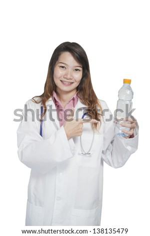 Portrait of Asia health care professional holding water bottle - stock photo