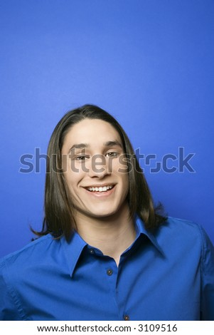 Portrait of Asian-American teen boy smiling. - stock photo