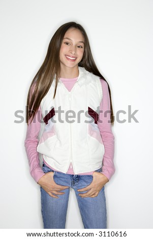 Portrait of Asian-American teen girl with thumbs in pockets standing against white background. - stock photo
