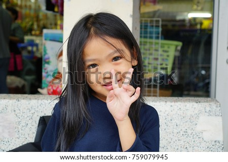 Portrait of Asian baby happy to play out door