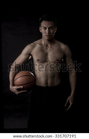 Portrait of Asian Basketball Player In Black Scene