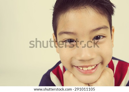 Portrait of asian boy with smile face wearing winter clothes ,Vintage style - stock photo