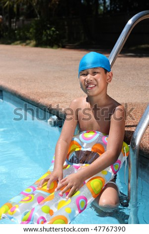 portrait of asian boy with swimming gear - stock photo
