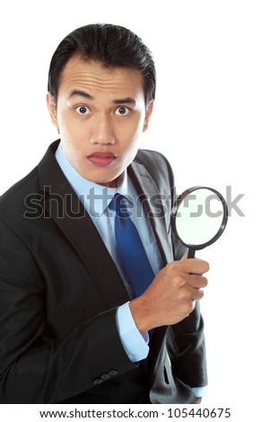 Portrait of asian business consultant holding a magnifier glass