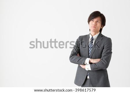 portrait of asian businessman isolated on white background - stock photo